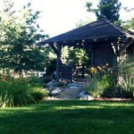 Pond-side seating in a shady pergola