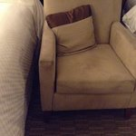 beige chair in room