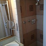 Bathroom - Shower does have good pressure and hot water supply despite signs warning of the cont