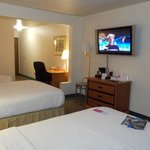 Large LCD TV with comfortable beds, large bathroom and ample sockets!