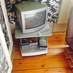 1ft high small tv and video cassettes but no video player!!lol