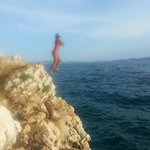 Cliff jumping at the local beach