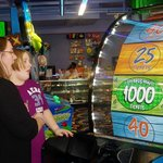 Arcade Room - Dtr. and granddaughter hitting the big one!