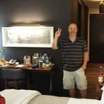 Rm 1114 Jul 2014 king big bathroom behind him