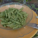 Penny with pesto sauce at the welcome dinner.