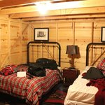 double full beds in each rustic cabin