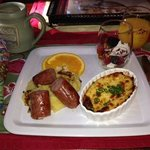 baked polenta w/ agave (delish!), sausage, cheese frittata, & fruit w/ greek yogurt!