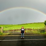 Me and a gigantic rainbow outside the front door at Finn Mc Cool's