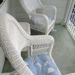 great wicker chairs and table on balcony