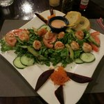 Shrimp salad with whiskey sauce.
