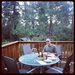Eating dinner from the delicios onsite restaurant on our deck at our private cabin.