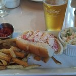 Lobster roll with fries and slaw
