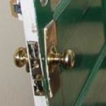 Door latch where key goes into knob.The backplate looks like it was jimmied