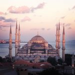View of Blue Mosque from roof terrace at sunset