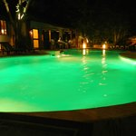 the pool at night has these cool green lights