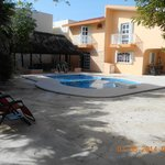 Patio/pool/portion of hostel/palapa/barbeque/pool chairs