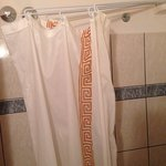 "The interesting shower curtain offered by at least 1 room in orfeas hotel - if your over 6' 2"" y"