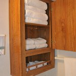 Bathroom stocked with fluffy white towels