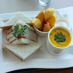 Carrot and coriander soup and ham sandwich