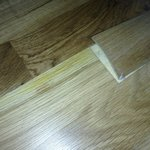 The cheap laminate floor in our tiny room