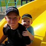 Both Grandsons playing on the play ground.