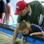 Petting the horseshoe crabs