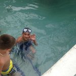 older grandson in the pool, they are all fish!!!