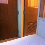 entrance door and bathroom door from the bed