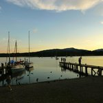 Setting sun over Lake Windermere across from Waterhead
