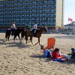Watching the horses riding by as we lay on the beach looking at our Courtyard by Marriott Virgin