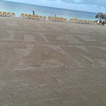The groomed beach early in the morning - it says Iberostar - One love - Jamaica