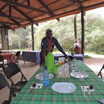 Francis our cook setting up breakfast at Mara Springs