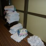 clean towels and sheets dropped on the floor in the corridor