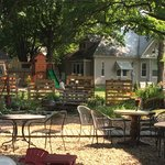 outdoor patio area under the gorgeous shade trees