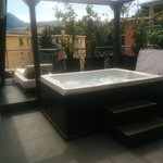Terrace with private jacuzzi and sunbed in room 404