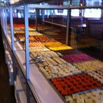 long tables covered with trays of sweets