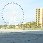 beach view of the hotel and sky wheel