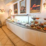 Just a small part of the breakfast buffet. Do not miss the fresh orange juice machine.