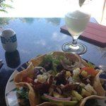 wonderful mexican salad with grilled pork, pineapple salsa and frozen margarita at Stone Grill