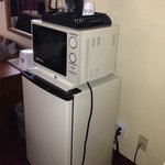 Microwave, coffee maker and fridge