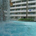 Hotel from under pool waterfall