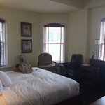 Large corner suite with hardwood floors, king bed, lots of windows and natural light