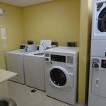 laundry facilities next to pool and gym