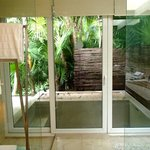 double shower with door to outdoor tub