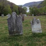Grave stones in Harpers Cemetery facing the lowest point in Harpers Ferry