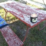 Peeling and chipping paint on picnic tables
