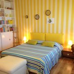 Yellow room with seaview new bed