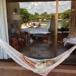 3 year old niece relaxing in the hammock off the balcony of their room, reflecting the dolphin p