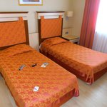 Double bed in alaiye resort and spa