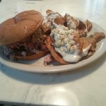 Chopped bbq sandwich with slaw side of blue cheese chips.